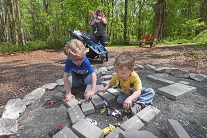 """Three miles of hiking trails, peppered with a number of """"movement stations"""" along the way, highlight this natural venue dedicated to the memory of a local 4-year-old. The mostly flat terrain features a fairy garden, swing bridge, climbing wall and other imaginative, nature-inspired sidelights built solely of logs, rocks and stumps. Bicycles and leashed dogs are welcome, and picnic grills are available. 2503 S. Tollgate Road., Bel Air. bearlegacy.org"""