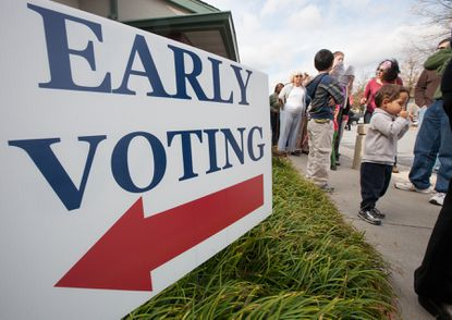 Kids accompanied their parents in the long line for early voting at the Ellicott City Senior Center Saturday Oct. 27.