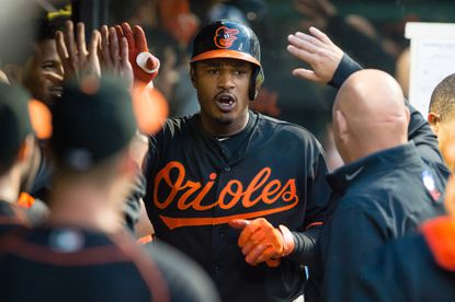 Orioles center fielderAdam Jones celebrates with teammates after hitting a solo home run during the sixth inning against the Cleveland Indians at Progressive Field on June 5, 2015 in Cleveland, Ohio.