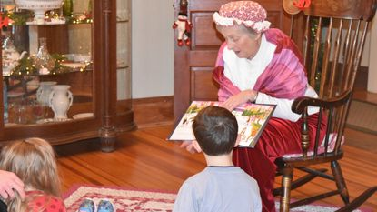 Mrs. Claus reads to kids at last year's Merry Main Street event in Dec. 8.