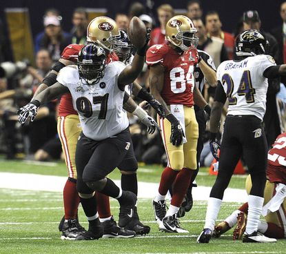 Arthur Jones recovers a fumble in the first half of Super Bowl XLVII between the Baltimore Ravens and the San Francisco 49ers at the Superdome in New Orleans Sunday.