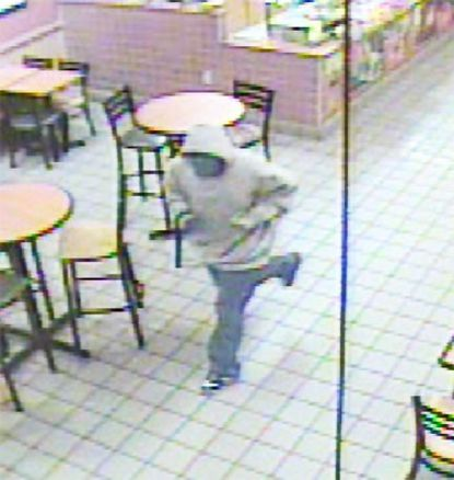 Security camera footage shows a man fleeing the Subway Restaurant in Churchville.