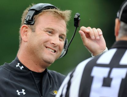 Towson coach Rob Ambrose speaks to an official during a college football game against St. Francis in Towson.