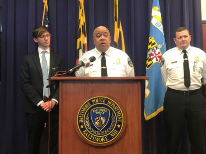 Baltimore Police Commissioner Michael Harrison (middle) discussed a broad new staffing plan mandated by the department's consent decree with the U.S. Department of Justice.