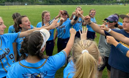 River Hill comes together for a post-game huddle after defeating Wilde Lake, 9-6, in the 3A East Region II semifinals on June 9, 2021.