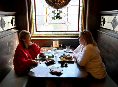 Friends Mary Ann Manly, left, and Pat Howard enjoy some conversation as they have some lunch at MaGerk's in Bel Air Wednesday, March 10, 2021.