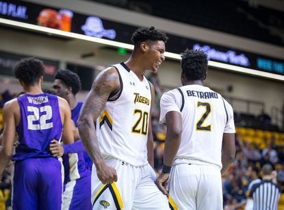 Nakye Sanders of Towson celebrates in the Tigers' victory over James Madison.