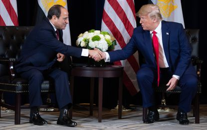 US President Donald Trump shakes hands with Egyptian President Abdel Fattah el-Sisi during a meeting on the sidelines of the UN General Assembly in New York, September 23, 2019. (Photo by SAUL LOEB / AFP) (Photo credit should read SAUL LOEB/AFP/Getty Images)