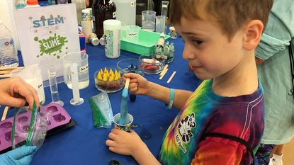 Connor Iwanowski learns how to make slime Saturday during a STEM experiment at Harford Fest.