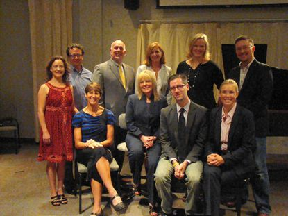 Artistic directors and staff orchestrating the performing arts schedule at Anne Arundel Community College include, from left: first row seated, Lynda Fitzgerald, Dawn Lindsay, Ian Wardenski and Anna Binneweg; and second row, Laura Garza, Christopher Ballengee, Douglas Byerly, Alicia Morse, Kristin Clippard and Sean Urbantke