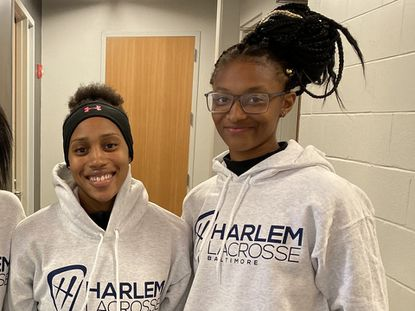 Harlem Lacrosse graduates Dymin Gerow, left, and Lenaijah Ferguson are seeking to set an example for future Black lacrosse players. The two will meet when UMBC and Hartford play a college lacrosse game Saturday.