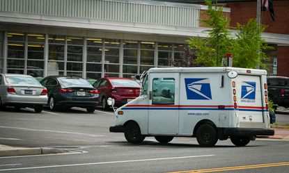 A mail carrier returns to the Parkville Post Office on Harford Road Thursday afternoon, one of several area post offices experiencing delays in mail delivery.