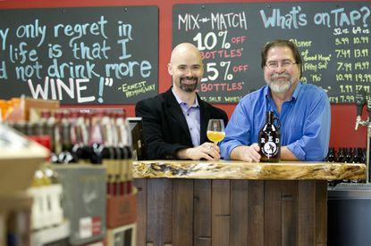 General manager Adam Harriger, left, and co-owner Jack Moore, right, pose for a photo at Red in Clarksville.