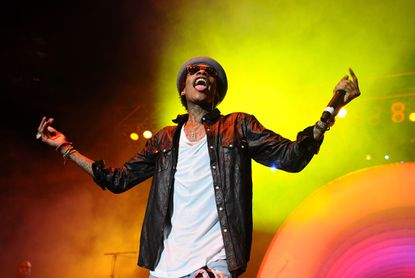 Wiz Khalifa, shown here performing in Indianapolis on Thursday, will headline this year's Preakness Infield with Maroon 5.