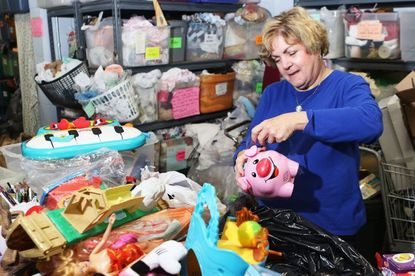 Janet Howser, of Arbutus, sorting used toys at the Southwest Emergency Services center, in Arbutus last week.