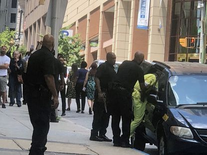 Keith Davis Jr. is escorted from the courthouse last year after being found guilty of gunning down a security guard in 2015, ending the fourth trial in a case that has brought two mistrials, an overturned conviction and national attention. He is scheduled to be sentenced by a judge this morning.