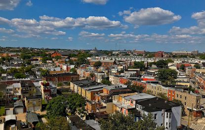 Baltimore's overall property tax rate is about twice that of surrounding counties.