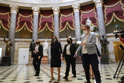 Speaker of the House Nancy Pelosi of Calif., walks through Statuary Hall on Capitol Hill in Washington, Wednesday, Jan. 13, 2021. (AP Photo/Susan Walsh)