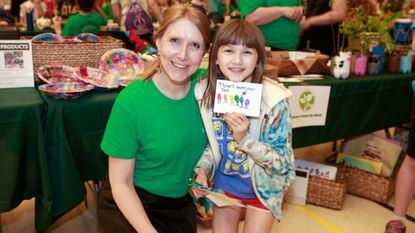 Bodkin Elementary School global studies teacher Melissa Major and student Alex Lyons attended the 11th annual Environmental and Local Culture Fair May 5. Alex and other global studies students created eco-friendly crafts to sell to raise money for the Chesapeake Bay Foundation.