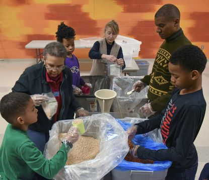 A group works together on Jan. 18, 2016 to pack meals for the hungry as Glen Mar United Methodist Church in Ellicott City holds its second annual Day of Service on MLK Jr. Day. This year the county will host the service day, its annual program and the NAACP will host a 5K race.