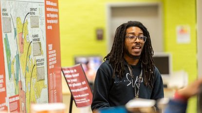 """Community outreach specialist Trent Day Hall will lead a """"reflection session"""" on Feb. 26 for those who have toured """"Undesign the Redline"""" at the Howard County Library System's Central Branch."""