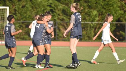 Gerstell goal scorer Gabrielle Manning (14) is hugged by teammate Emily Messinese after scoring against Liberty on a penalty kick during a girls soccer game at Gerstell Academy on Sept. 4, 2018.