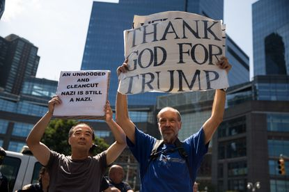 A supporter of President Donald Trump, right, makes himself heard during a protest against white supremacy and racism on Aug. 13, 2017, in New York City.