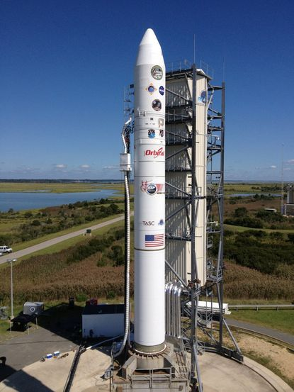 The Minotaur V rocket that will carry NASA's LADEE mission into orbit, bound for the moon, was rolled back on a launch site at NASA's Wallops Flight Facility on Sept. 4.