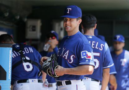 Texas Rangers' Drew Stubbs stands in the dugout in the first inning of a baseball game against the Chicago White Sox on Wednesday, May 11, 2016, in Arlington, Texas.