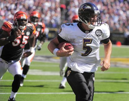 Ravens rookie quarterback Joe Flacco runs downfield, being chased by the Cincinnati Bengals' Keith Rivers, on the way to a 38-yard touchdown in the third quarter. Flacco was 15-for-29 for 129 yards with no interceptions.
