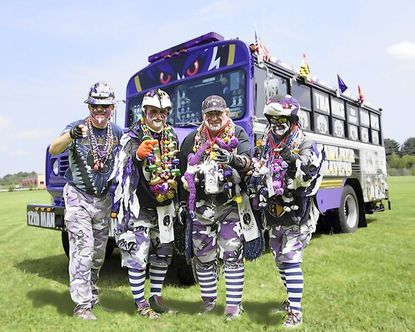 The ultimate Ravens fans, Raven Rick, Fan Man, Maniac and Camo Man, and their pride and joy, the Fan Bus