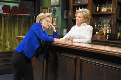 "In this Saturday, Oct. 3, 2015, photo, provided by NBC, Kate McKinnon, left, portraying Hillary Rodham Clinton, and Hillary Rodham Clinton, right, portraying Val, appear during the ""Bar Talk"" sketch on ""Saturday Night Live,"" in New York. Most political candidates play themselves on ""SNL,"" often for just a cameo in a sketch or to declare the show's famous tag line, ""Live from New York, it's Saturday night!"" Seldom do they play a character in a sketch, as did Clinton. (Dana Edelson/NBC via AP) ORG XMIT: NY112 ** Usable by LA and DC Only **"